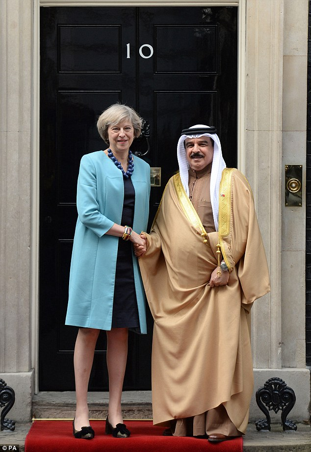 Prime Minister Theresa May greets the King of Bahrain, Hamad bin Isa Al Khalifa, at Downing Street after the attack on his car