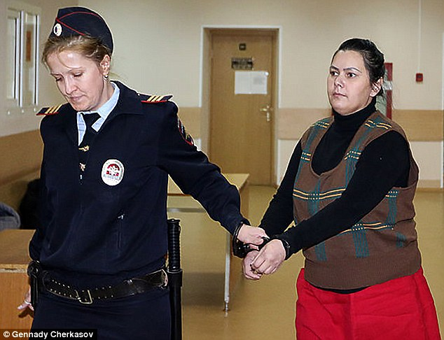 Gyulchehra Bobokulova, the nanny who beheaded the four-year-old disabled girl she was caring for, will not be tried as a terrorist because she has been deemed mentally ill. Pictured: Bobokulova being brought into court