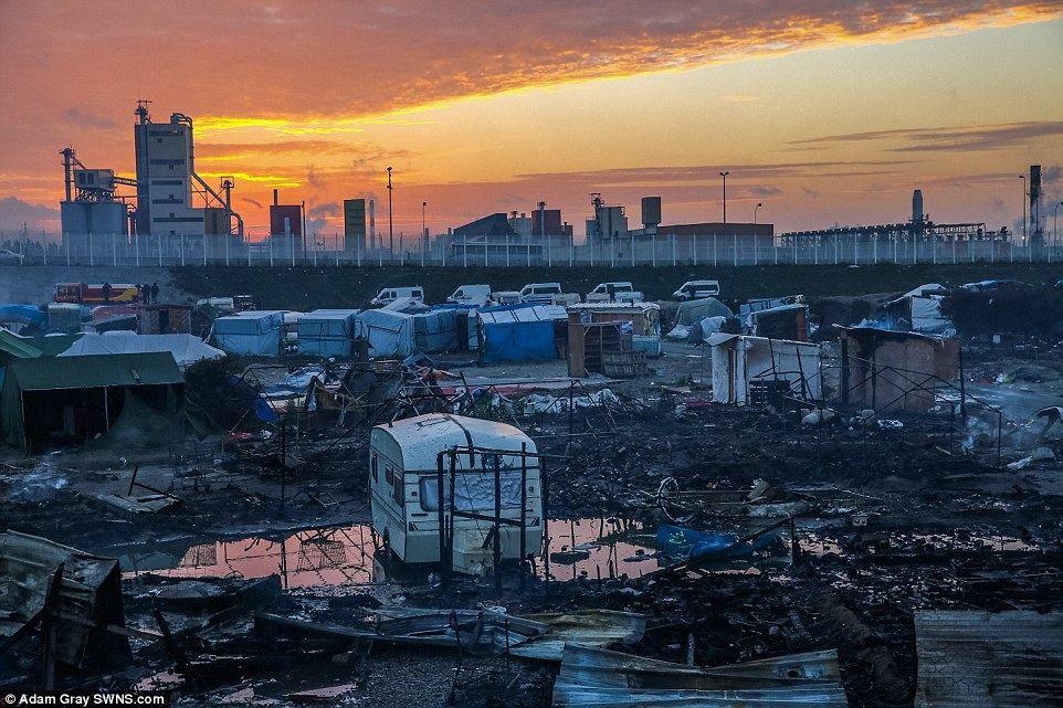 The sun sets tomorrow on a scene of destruction with the Jungle virtually empty, the shacks all burned