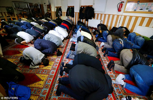 Muslims pray during Friday prayers at the Turkish Kuba Camii mosque located near a hotel housing refugees in Cologne's district of Kalk, Germany