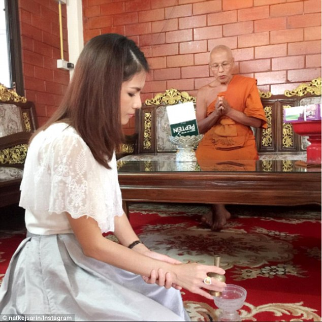 'Nong Nat' (pictured) is now taking Buddhism seriously