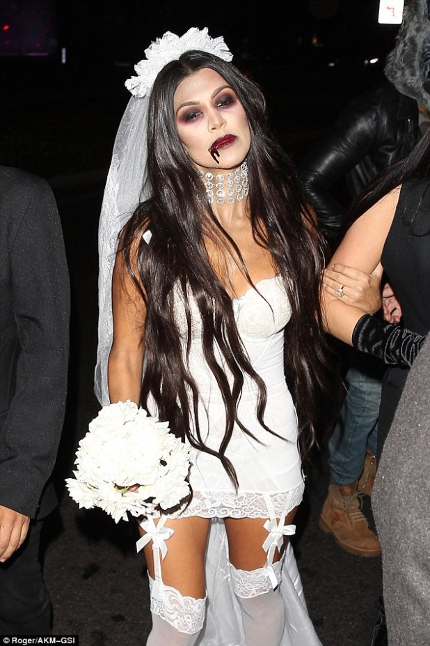 Stunner: The 37-year-old reality star put on a spooky display as a zombie bride, showing off her incredible figure