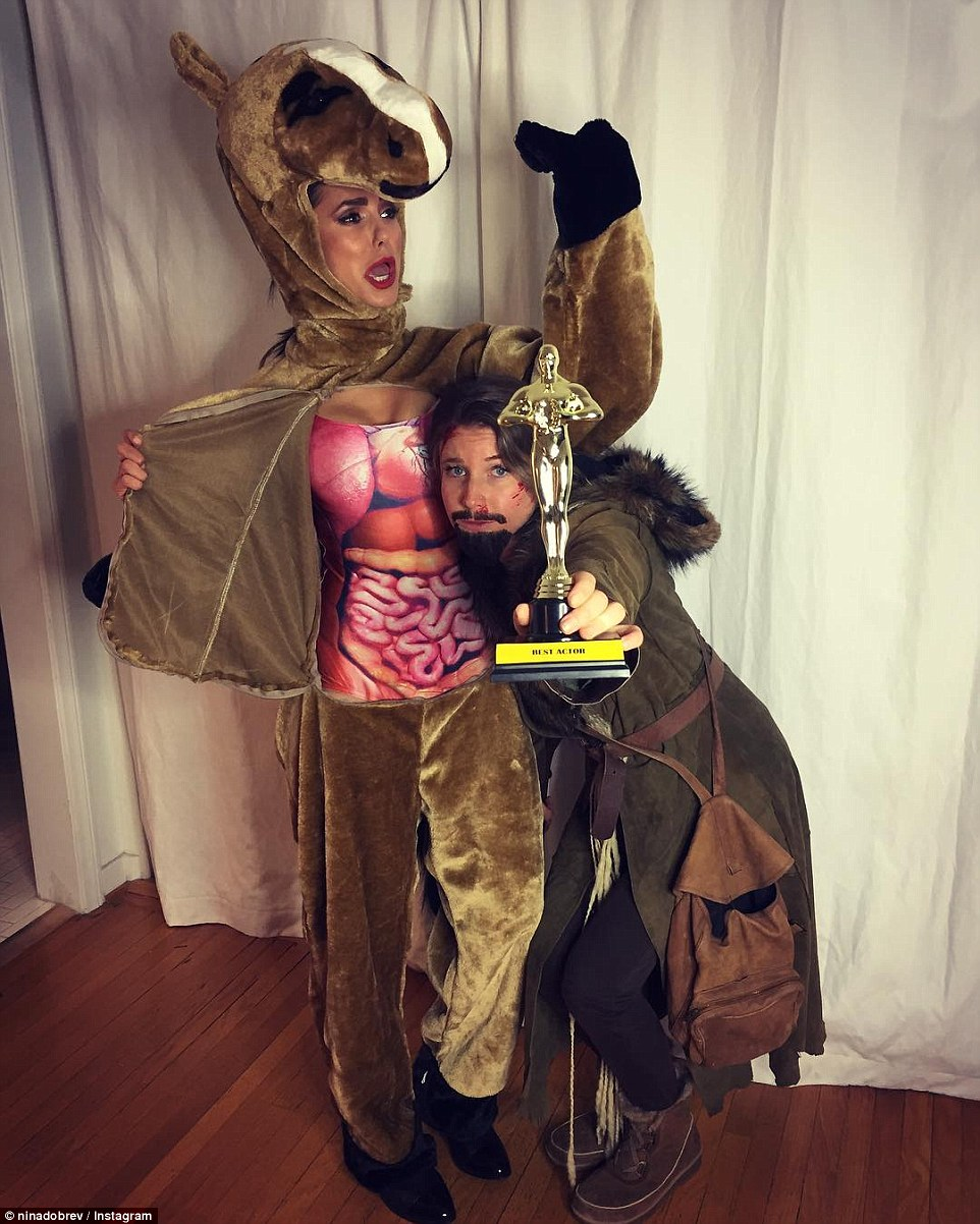 Vampire Diaries star Nina Dobrev went for the laughs with her Halloween costume, dressing up as the horse from The Revenant while her pal wore a Leonardo DiCaprio costume complete with an Oscar in hand