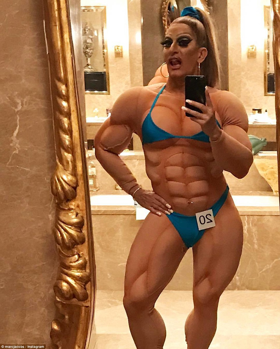 Also in attendance at Midler's party was designer Marc Jacobs, who dressed as a female bodybuilder - complete with a six pack bodysuit, Christian Louboutin heels and a tiny blue bikini