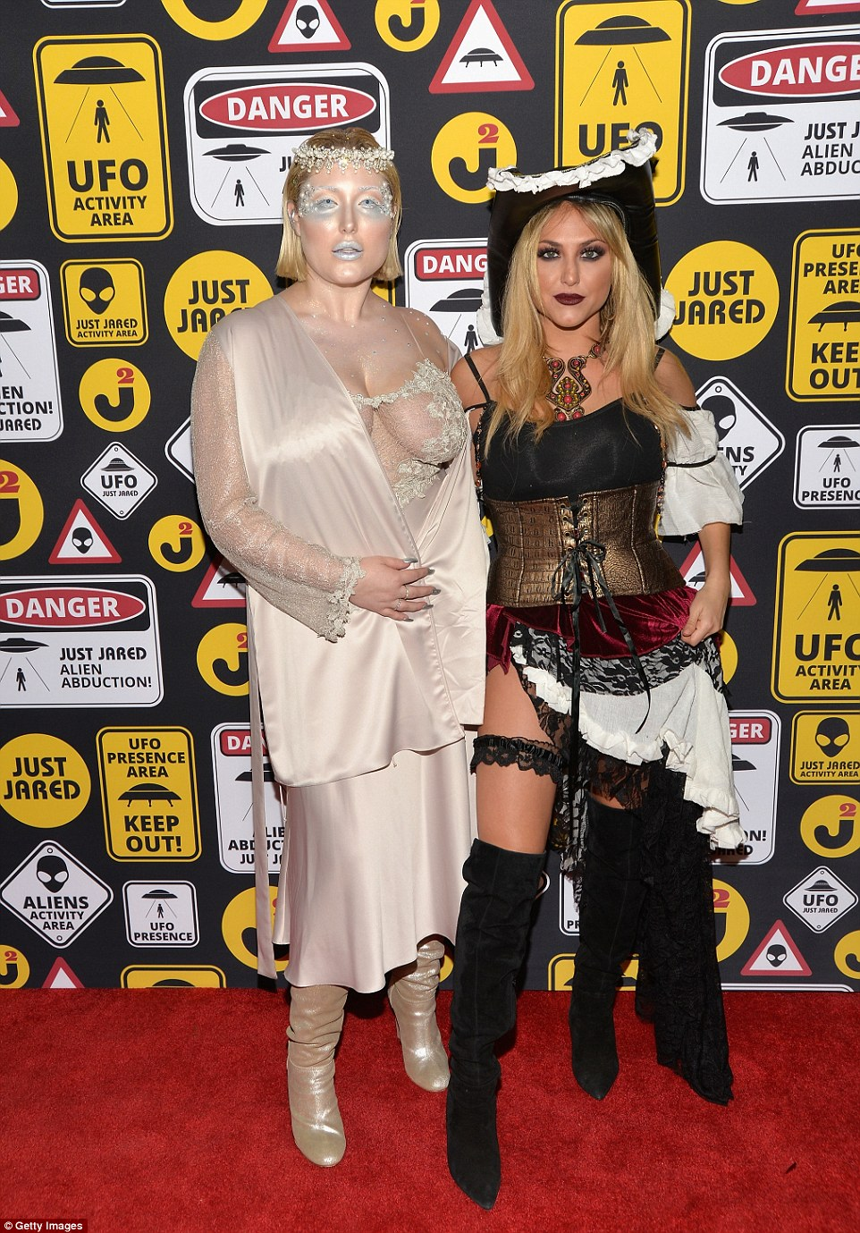 Daring: David Hasselhoff's daughter Hayley left almost nothing to the imagination in a sheer top as she joined pirate-clad pal Cassie Scerbo