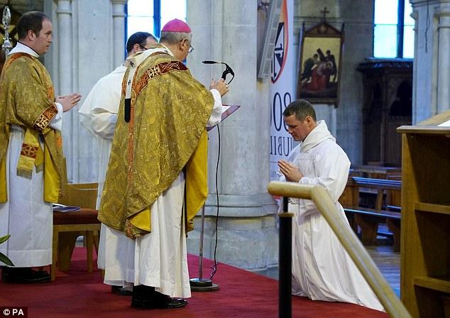 Philip Mulryne (right) kneels beforethe Archbishop of Dublin, Diarmuid Martin, on Saturday
