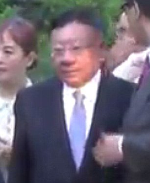 Chinese government front? Wang Wenliang, the billionaire McAuliffe at first claimed he had never met, filmed entering a fundraiser attended by the governor at Clinton's home