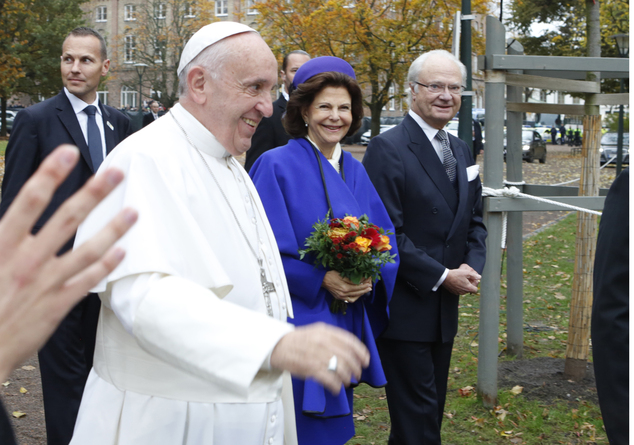 Pope Francis, Sweden's Queen Silvia, centre and King Carl Gustaf arrive at the King's House