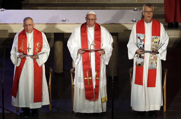 Pope Francis is flanked by the General Secretary of the Lutheran World Federation Rev. Martin Junge, right, and the President of the Lutheran World Federation Bishop Munib Younan