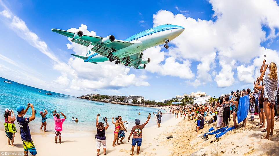The last-ever hair-raising landing by a jumbo belonging to KLM on St Maarten was made on Friday (pictured)