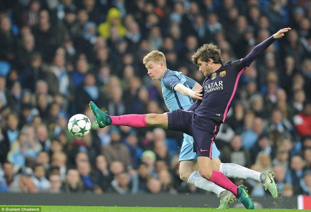 Sergi Roberto (right) challenges City's 25-year-old Belgian star De Bruyne on an exciting night in north-west England