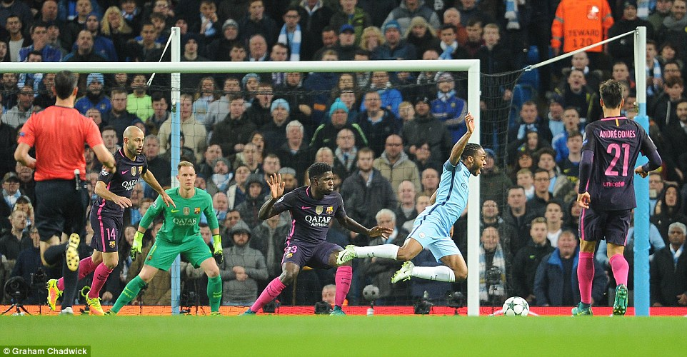 Sterling goes to ground in the box after a challenge by Barca's French defender Samuel Umtiti (centre) in the first period