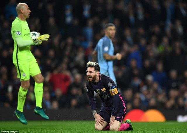 Messi smiles in disbelief after thinking that he should have received a penalty following a Fernandinho sliding tackle
