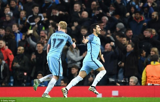 Gundogan (right) celebrates his second goal of the match with Kevin De Bruyne (left), in the 74th minute