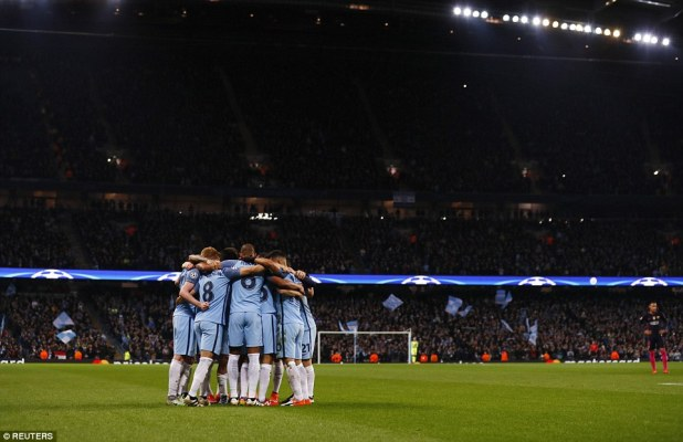 City's players gather in a huddle after their third goal against Luis Enrique's La Liga giants at the Etihad Stadium