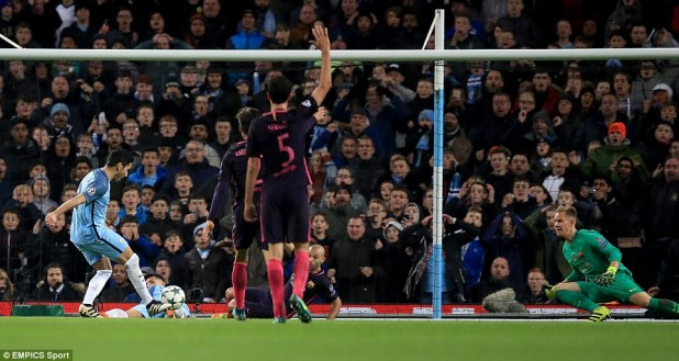 Manchester City's IIkay Gundogan (left) scores his side's third goal in an epic contest with Barcelona on Tuesday night