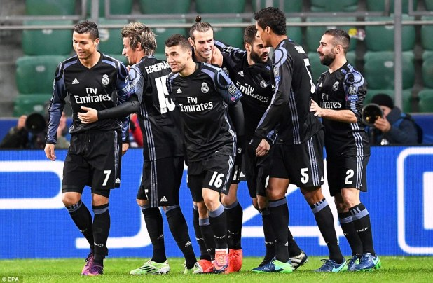 Real Madrid players celebrate after Gareth Bale scored a stunning opening goal against Legia Warsaw