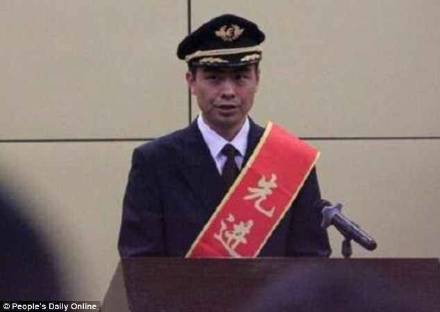 Heroic actions: The captain of the flight, He Chao, was given £360,000 at a ceremony today