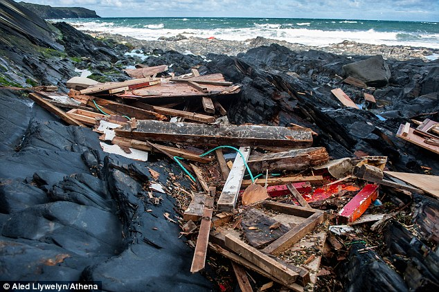 The smashed remains of the 'Harvester' after it crashed on to rocks along the Pembrokeshire coast