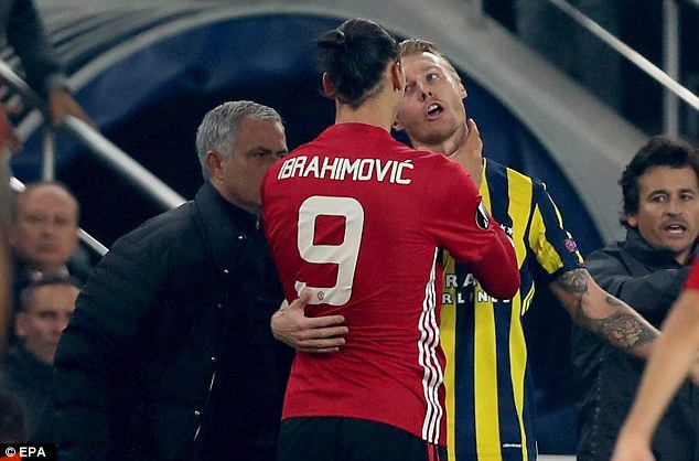 Jose Mourinho still had his eyes on the match as Ibrahimovic and Kjaer clashed on touchline