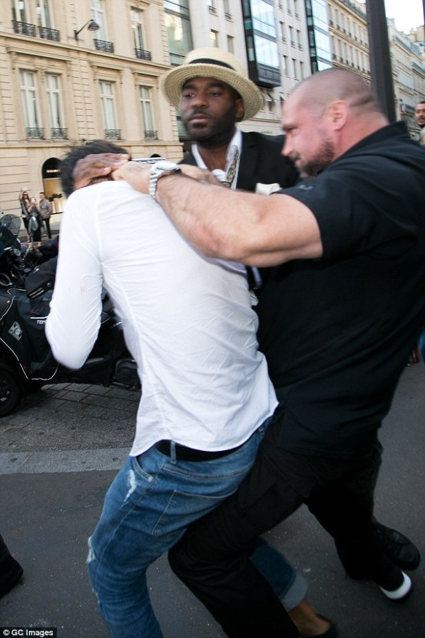 Takedown: Pascal slammed celebrity prankster Vitalii Sediuk to the ground when he came up behind Kim and tried to grab her the day before the attack (above)
