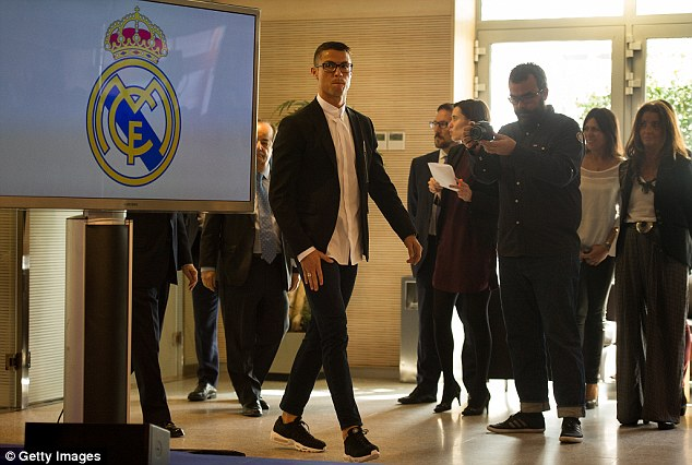 Real's No 7 arrives for his press conference on Monday to speak about his new contract
