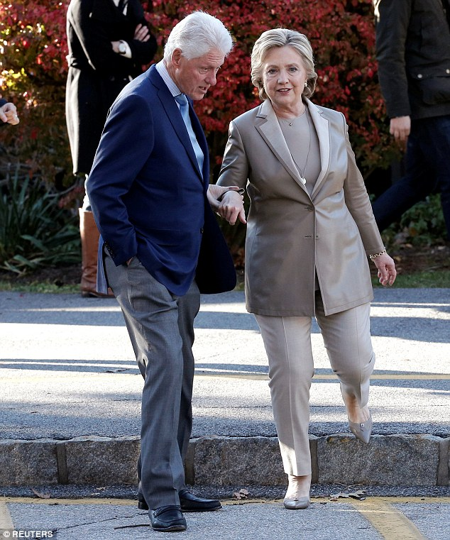 Hillary Clinton (right) was escorted to the polls by her husband ex-president Bill Clinton (left) - as the political power couple both casts their votes in Chappaqua, New York