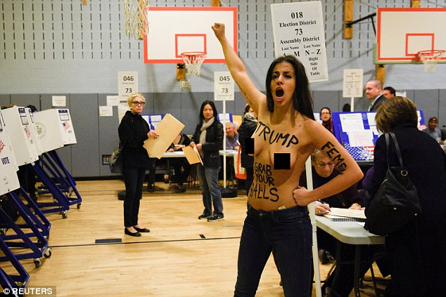 The protesters raised their fists in the air and chanted, 'Trump, grab your balls' as they demonstrated at the New York polling station