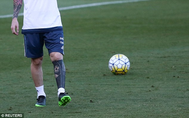 Messi has scrapped his old tattoos and instead had them coloured in with plain black ink