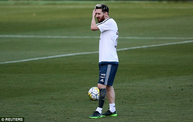 Lionel Messi in training for Argentina with his new tattoo clearly visible on his left leg