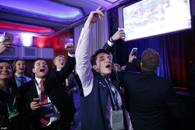 Young Trump supporters celebrate at the Republican nominee pulls ahead in the presidential race