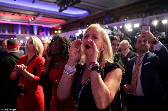 A woman at Trump's election rally in New York cheers as election results are shown to the Republican nominee's supporters