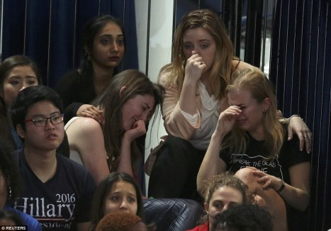 A group of Hillary Clinton supporters at her election night rally comfort one another as they break down in tears over the presidential results