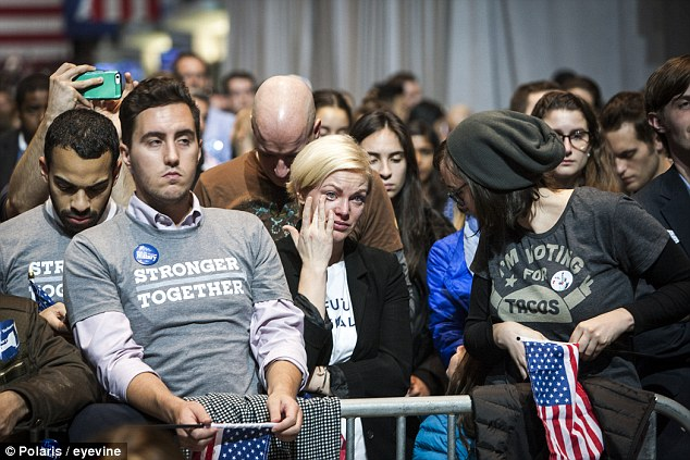 Hillary Clinton supporters cry as they follow the presidential election results