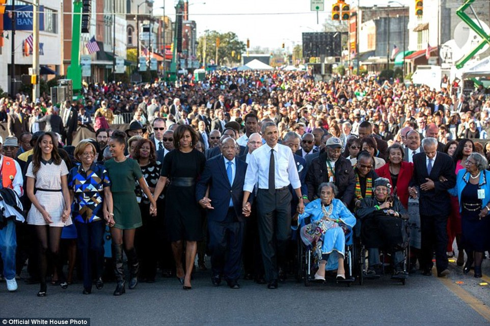 March 7, 2015. 'For Presidential trips, I usually have another White House photographer accompany me so he or she can preset with the press and obtain angles that I can't, as I usually stay close to the President. Lawrence Jackson made this iconic image from the camera truck as the First Family joined others in beginning the walk across the Edmund Pettus Bridge'