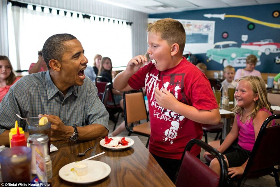 President Barack Obama shares his strawberry pie with a boy during a lunch stop at Kozy Corners restaurant in Oak Harbor, Ohio, July 5, 2012