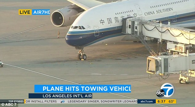 A tow truck collided with a China Southern Airlines plane that it was pulling at Los Angeles International Airport on Thursday night