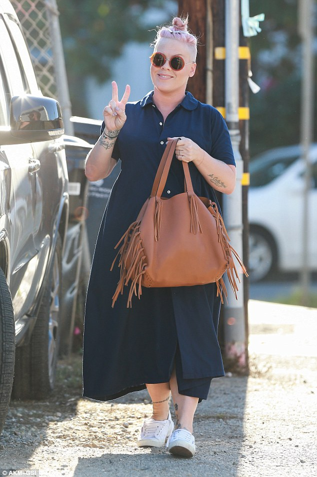 One on the way: Pink, 37, was glowing as she stepped out in Santa Monica on Friday one day before confirming on Instagram that she and her husband Carey Hart were expecting a second child