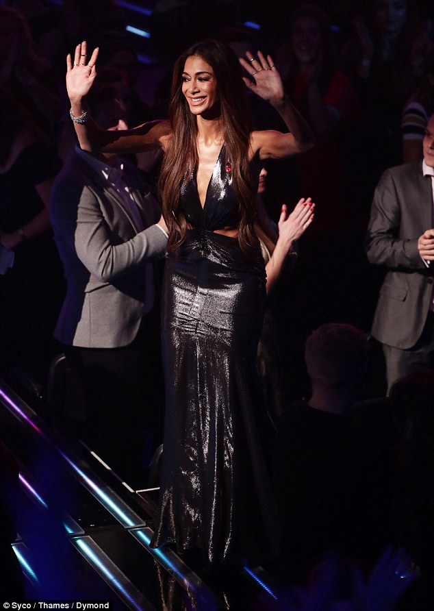 Slinky: The star happily waved to fans while showing off her stunning figure in the full length number