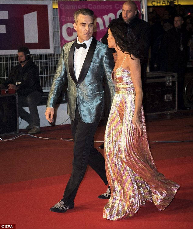 Glam pal: The hit singer, 42, cut a dapper figure as he escorted the stunning French singer Jenifer on the red-carpet
