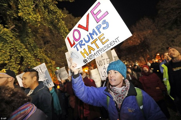 Protesters hold signs during an election protest in Lafayette Square Park in front of the White House, Saturday, Nov. 12