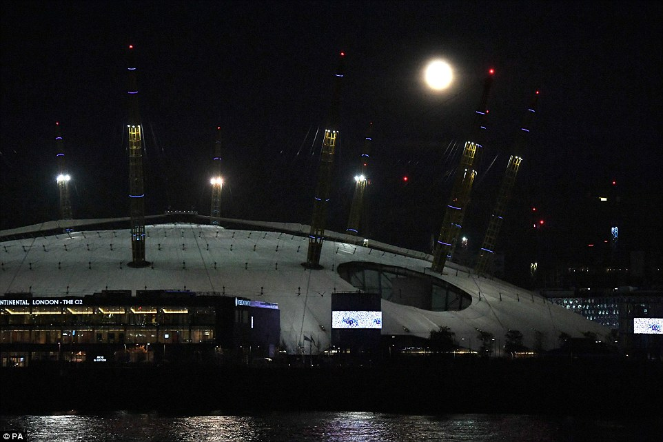 The moon's orbit is elliptical rather than perfectly circular, so as the moon moves around the Earth it is sometimes a little bit closer and sometimes a bit further away from us. It is seen here above the 02 Arena, south-east London