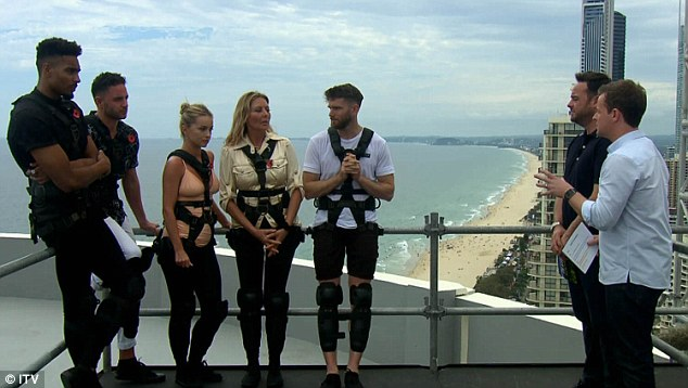 Flying high... For their first terrifying task, the fivesome were forced to walk along a narrow plank suspended on top of the Focus Tower on Australia's Gold Coast