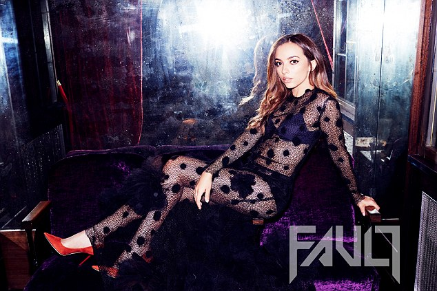 At ease: Jade Thirlwall posed casually in an ensemble comprising of a sheer black poker dot dress orange pumps by Jimmy Choo and lingerie by Calvin Klein, visible through the dress and accentuating her slender physique
