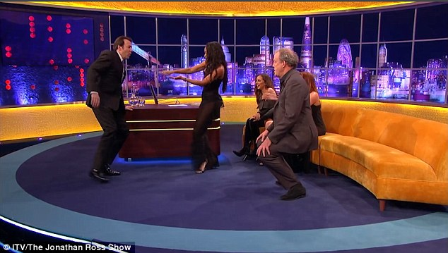 Taking charge: Appearing on Jonathan Ross' chat show sofa on Saturday night, Leigh-Anne was wearing the perfect outfit for the job, as she was already drawing attention to her perfect curves in a leotard and sheer jumpsuit
