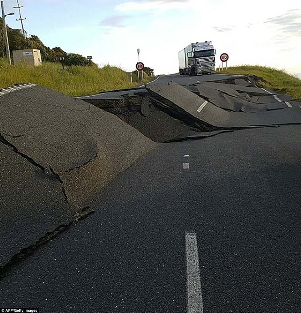 The inital earthquake ripped up State Highway 1 (pictured) on the east coast