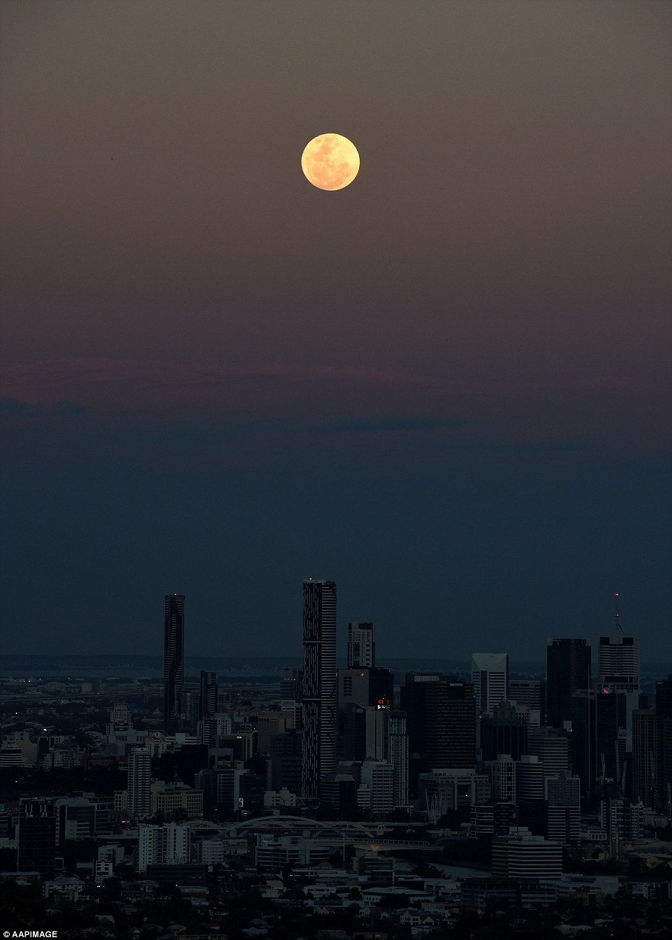 The dark sky showed the supermoon in full force as photographers from Brisbane jumped at the rare sight