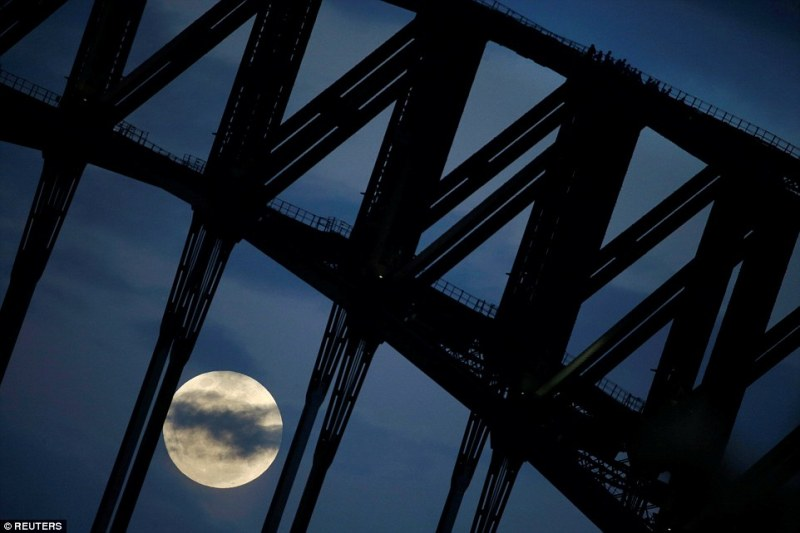Experts suggest that, provided that the sky is clear and you have a view to the south, the moon will be clearly visible. For an even better view, try viewing from a spot with as little light pollution as possible. Participants in a Sydney Harbour Bridge Climb  walk down the western span of the famous Australian landmark as the supermoon rises