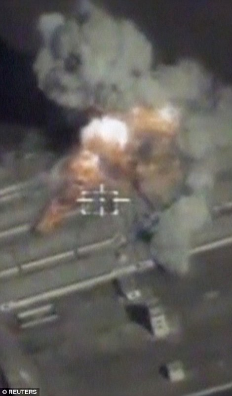 Trump said on Friday he would most likely seek an agreement with Vladimir Putin. He said: 'I've had an opposite view to many people regarding Syria.' Pictured is a Russian airstrike in Syria