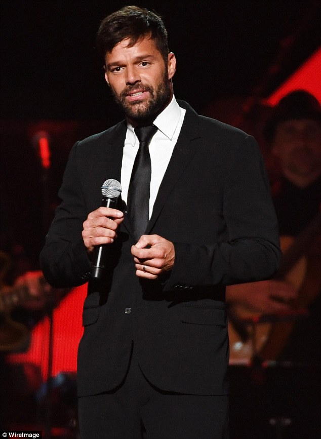 Proud: Having gone public with his engagement to Jwan Yosef hours before, Ricky Martin proudly showed off his sparkling engagement ring as he took to the stage in Las Vegas
